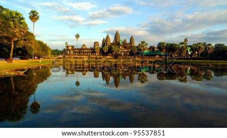 Angkor Wat and reflecting pool at sunset, Siem Reap, Cambodia - stock photo