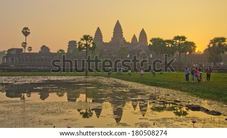 ANGKOR WAT - JAN ,5 : tourists at temple Angkor Wat on Jan 5,2014 in Siem Reap,Cambodia.Templ es of Angkor are the most famous attraction in Cambodia with more than 2 milion visitors per year. - stock photo