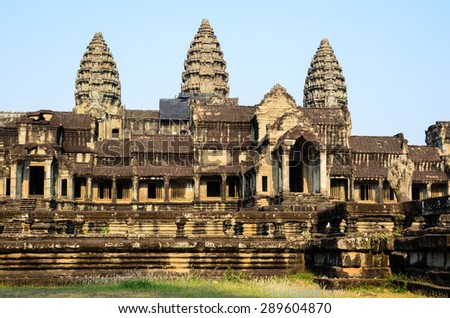 Angkor Wat, part of Khmer temple complex, popular among tourists ancient landmark and place of worship in Southeast Asia. Siem Reap, Cambodia. View from the rear, eastern part. - stock photo