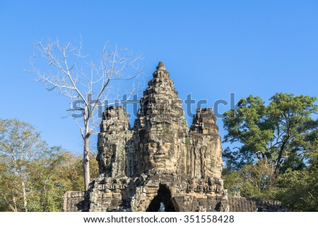 Angkor Wat Stone Gate of Bayon temple at Angkor Wat, part of Khmer temple complex, Asia. Siem Reap, Cambodia. Ancient Khmer architecture in jungle. - stock photo