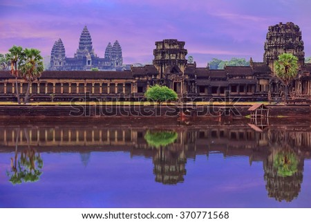 Angkor Wat Temple complex view at the main entrance over the early morning sunrise sky. Located near Siem Reap, Cambodia - stock photo