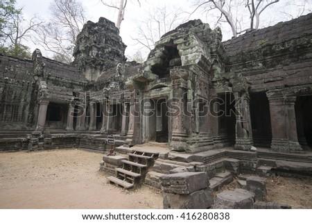 Angkor Watt - Ta Prohm temple ruin walls of the khmer city of angkor wat - stock photo