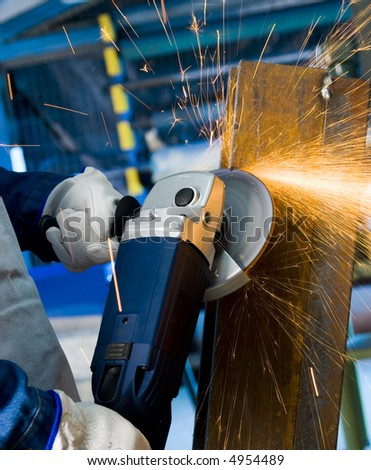 angle grinder cutting steel with sparks - stock photo