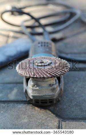 Angle grinder with  abrasive disk for grinder. - stock photo