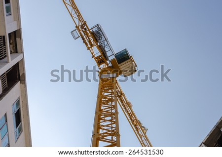 angle of elevation of tower crane in construction site - stock photo