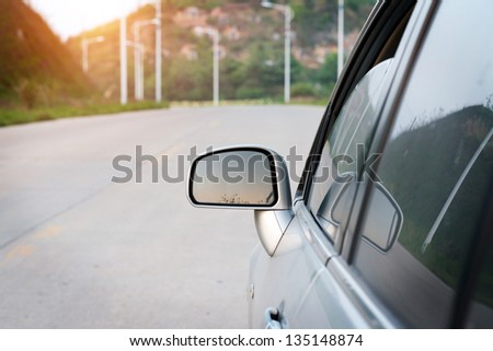 Angle shot of a car against sunset in the background - stock photo