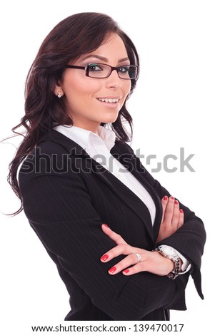 angle view of a young business woman holding her hands crossed and smiling to the camera. on white background