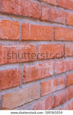 Angle view of brick wall background texture in shallow depth of field - stock photo