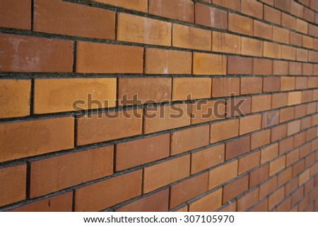 Angle view of brick wall background texture in shallow depth of field
