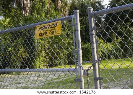 Angled gate with keep out sign - stock photo
