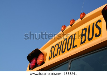 angled school bus with space for writing-front - stock photo