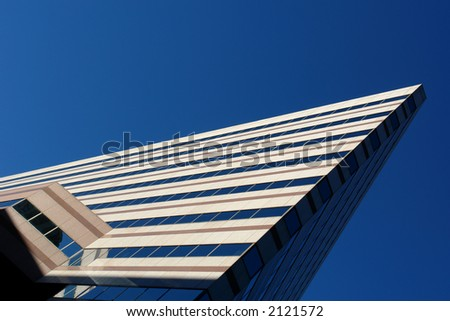 Angled sky scraper in boston's south end shows severe angle and bright blue sky
