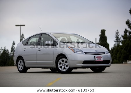 Angled view of a silver 2007 Toyota Prius, a hybrid car. - stock photo
