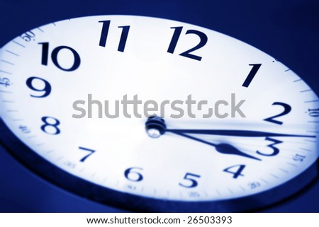 Angled view of clock, showing 3:15.  Insomnia strikes!  Differential focus, in blue tone. - stock photo