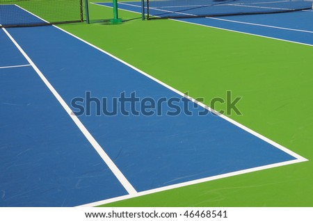 Angled View of Outdoor Tennis Court in Florida Resort Community - stock photo