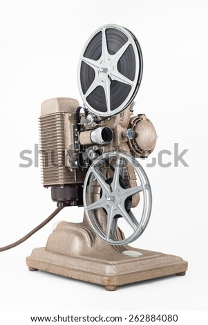 Angled view of Vintage 8 mm Movie Projector with Film Reels. Film is threaded through Projector. - stock photo