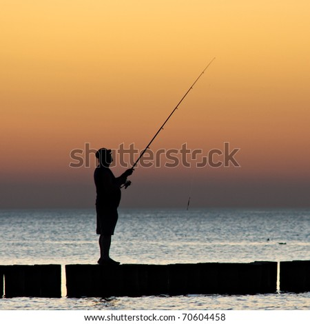 Angler fishing from groyne