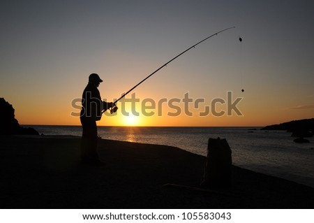 Angler's shadow in evening sun