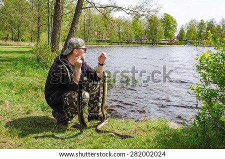 Angler with eels  - stock photo