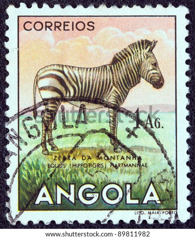"ANGOLA - CIRCA 1953: A stamp printed in Angola from the ""Angolan fauna"" issue shows a zebra, circa 1953."