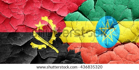 Angola flag with Ethiopia flag on a grunge cracked wall - stock photo