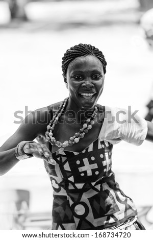 ANGOLA, LUANDA - MARCH 4, 2013:  Angolan beautiful woman dances the national falk dance in black and white in Angola, Mar 4, 2013. Music is one of the main African entertainments. - stock photo