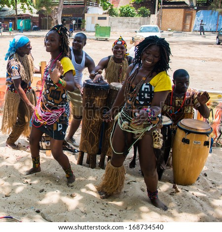 ANGOLA, LUANDA - MARCH 4, 2013:  Unidentified Angolan women make the street performance of the national folk dance for tourists in Angola, Mar 4, 2013. Music is one of the main African entertainments. - stock photo