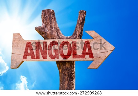 Angola wooden sign with sky background - stock photo