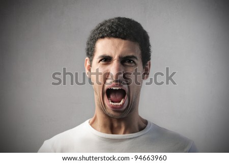 Angry african man screaming - stock photo
