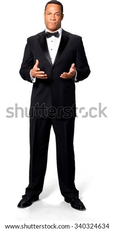 Angry African man with short black hair in evening outfit holding invisible object - Isolated