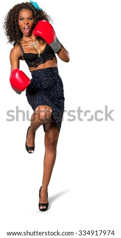 Angry African woman with medium dark brown hair in casual outfit kicking - Isolated - stock photo