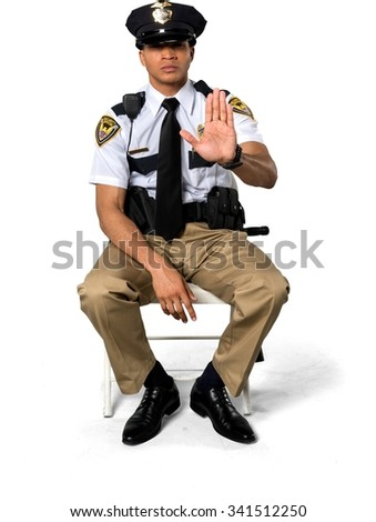Angry African young man with short black hair in uniform showing stop hand - Isolated - stock photo