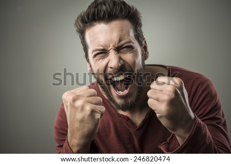 Angry aggressive man shouting out loud with ferocious expression - stock photo