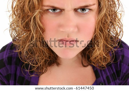 Angry american teenager standing over white background.