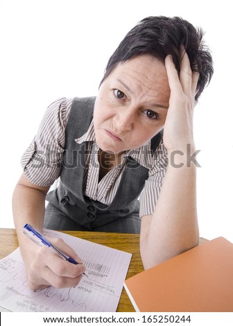 angry and exhausted teacher marking students work  - stock photo
