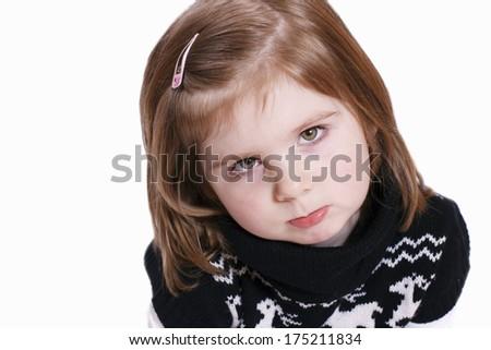 Angry and sad little girl - stock photo