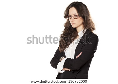 angry and sad pretty girl with hands crossed on white background - stock photo