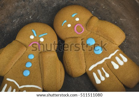 Angry and scared gingerbread men. Selective focus
