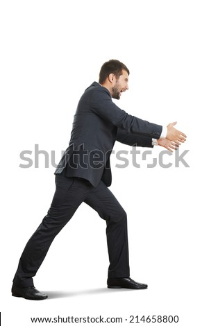 angry and screaming businessman stretching his arms. isolated on white background  - stock photo