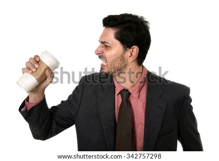 angry and stressed businessman in suit and tie crushing empty cup of take away coffee in caffeine addiction concept isolated on white background