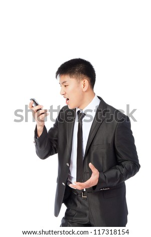 Angry asian business man screaming on cell mobile phone, portrait of young handsome businessman isolated over white background, concept of executive yelling, conversation problem communication crisis - stock photo