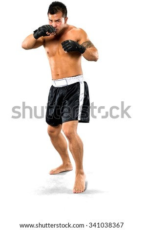 Angry Asian man with short black hair in athletic costume being in boxing stance - Isolated