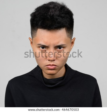 Angry Asian woman with short hair