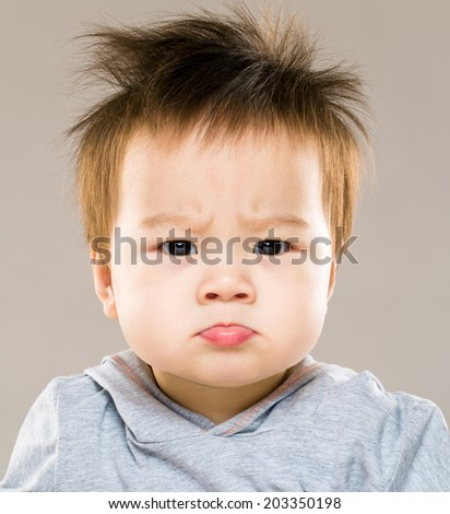 Angry baby boy - stock photo