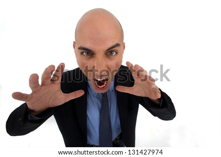 Angry bald businessman - stock photo