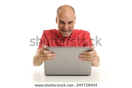 angry bald man with laptop computer. Isolated on white - stock photo