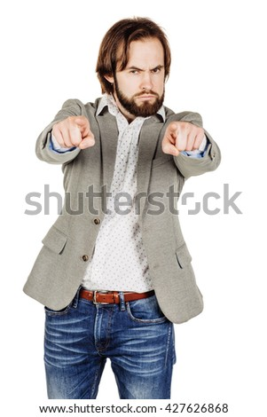 Angry bearded man pointing his finger against somebody. human emotion, facial expression, feeling attitude. image isolated white background. - stock photo