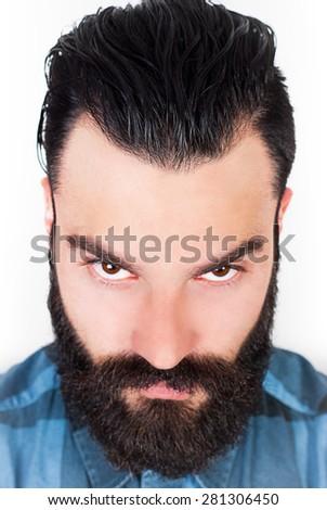 Angry bearded man. Selective focus. - stock photo