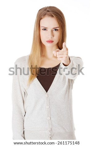 Angry blonde woman pointing on you.