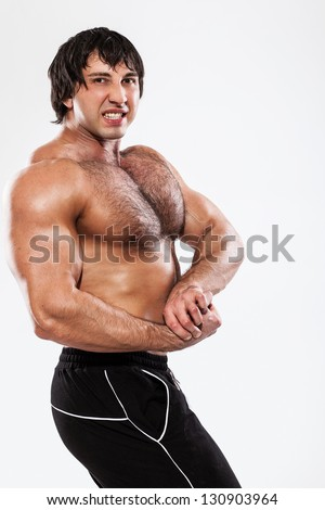 Angry bodybuilder with naked torso - stock photo
